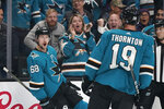 San Jose Sharks center Melker Karlsson (68) celebrates with teammate Joe Thornton (19) after scoring a goal against the Winnipeg Jets during the first period of an NHL hockey game in San Jose, Calif., Wednesday, Nov. 27, 2019. (AP Photo/Tony Avelar)