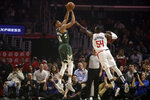 Milwaukee Bucks' Giannis Antetokounmpo, left, shoots over Los Angeles Clippers' Patrick Patterson (54) during the first half of an NBA basketball game Wednesday, Nov. 6, 2019, in Los Angeles. (AP Photo/Marcio Jose Sanchez)