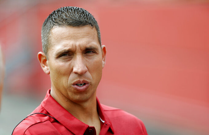 "FILE - In this Aug. 7, 2018, file photo, Iowa State coach Matt Campbell speaks to a reporter during the NCAA college football team's media day in Ames, Iowa.  The Cyclones will lean on Tarique Milton and Deshaunte Jones, both of whom saw significant snaps a year ago, and hope for a few young players to emerge in the months ahead. ""We think there are some really talented guys there,"" Campbell said. ""There are certainly some different guys that have risen to the occasion. What great competition breeds (is) some success, and that's been really fun to watch."" (AP Photo/Charlie Neibergall, File)"