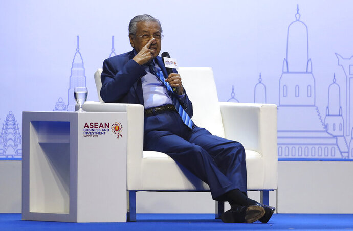 Malaysian Prime Minister Mahathir Mohamad gestures as he speaks during the ASEAN Business and Investment Summit (ABIS), a parallel event to the ASEAN summit in Nonthaburi, Thailand, Saturday, Nov. 2, 2019. (AP Photo/Aijaz Rahi)