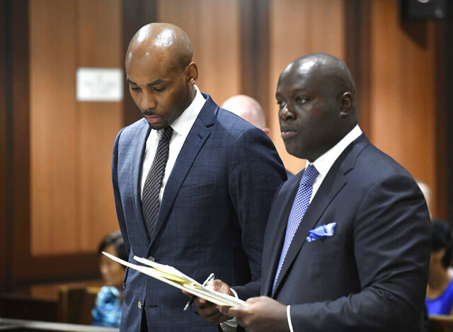 FILE - In this Aug. 9, 2018 file photo, Jamill Jones, left, appears in Queens Criminal Court in New York. The former Wake Forest men's assistant basketball coach was sentenced Thursday, July 23, 2020, to three years of probation, community service and a fine for fatally punching a man in New York City who pounded on his car's window in August 2018. (Barry Williams/Dailymail.com via AP, Pool, File)