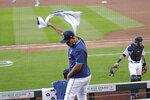 Seattle Mariners' Justus Sheffield waves a towel from his seat behind the team dugout after a double play against the Oakland Athletics ended the top of the third inning of a baseball game Saturday, Aug. 1, 2020, in Seattle. (AP Photo/Elaine Thompson)