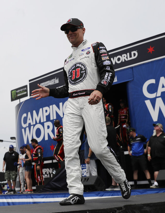 Kevin Harvick waves to the crowd during driver introductions before a NASCAR Cup Series auto race at Chicagoland Speedway in Joliet, Ill., Sunday, June 30, 2019. (AP Photo/Nam Y. Huh)