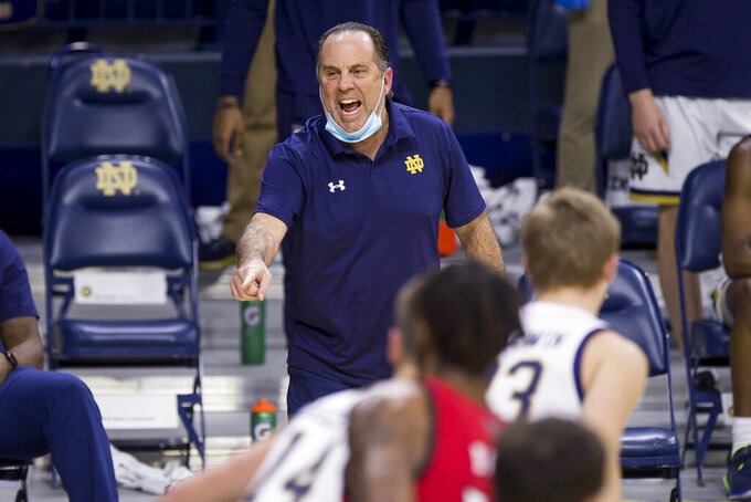 Notre Dame head coach Mike Brey directs players during the first half of an NCAA college basketball game against North Carolina State on Wednesday, March 3, 2021, in South Bend, Ind. North Carolina State won 80-69. (AP Photo/Robert Franklin)