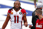 FILE - In this Dec. 13, 2020, file photo, Arizona Cardinals' Larry Fitzgerald warm up before an NFL football game against the New York Giants in East Rutherford, N.J. Cardinals 11-time Pro Bowl receiver Fitzgerald says he currently does not have the desire to play an 18th NFL season, though he left the possibility open that he might resume his career. (AP Photo/Noah K. Murray, File)