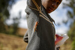 A locust lands on a young girl at a farm in Elburgon, in Nakuru county, Kenya Wednesday, March 17, 2021. It's the beginning of the planting season in Kenya, but delayed rains have brought a small amount of optimism in the fight against the locusts, which pose an unprecedented risk to agriculture-based livelihoods and food security in the already fragile Horn of Africa region, as without rainfall the swarms will not breed. (AP Photo/Brian Inganga)