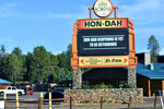 In this Thursday, June 25, 2020 photo provided by C.M. Clay, the sign at Hon-Dah Resort Casino in Pinetop, Ariz., informs the public that a reopening date has yet to be determined. The White Mountain Apache Tribe, which owns the casino, is implementing weekend lockdowns to help slow the spread of the coronavirus. (C.M. Clay/White Mountain Apache Tribe via AP)