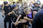 New York Police officers use pepper spray on protesters during a demonstration Saturday, May 30, 2020, in the Brooklyn borough of New York. Protests were held throughout the city over the death of George Floyd, a black man who was killed in police custody in Minneapolis on Memorial Day.  (AP Photo/Seth Wenig)