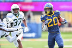West Virginia running back Alec Sinkfield (20) rushes the ball against Baylor during an NCAA college football game, Saturday, Oct. 3, 2020, in Morgantown, W.Va. (William Wotring/The Dominion-Post via AP)