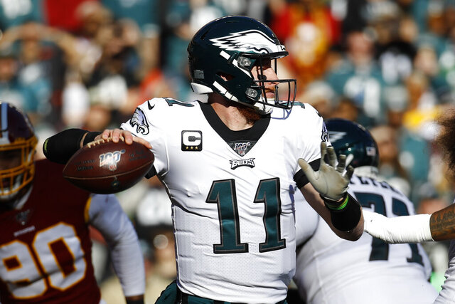 Philadelphia Eagles quarterback Carson Wentz (11) passes the ball against the Washington Redskins in the first half of an NFL football game, Sunday, Dec. 15, 2019, in Landover, Md. (AP Photo/Patrick Semansky)