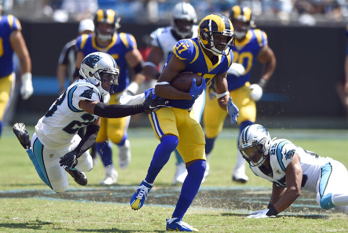 Carolina Panthers cornerback Javien Elliott (23) reaches to tackle Los Angeles Rams wide receiver Robert Woods (17) during the first half an NFL football game in Charlotte, N.C., Sunday, Sept. 8, 2019. (AP Photo/Mike McCarn)