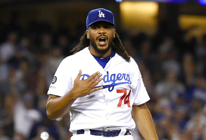FILE - In this July 19, 2019 file photo, Los Angeles Dodgers relief pitcher Kenley Jansen celebrates after the Dodgers defeated the Miami Marlins 2-1 in a baseball game in Los Angeles. In what's become a familiar refrain, the Dodgers arrive at camp still looking for their first World Series championship since 1988. After losing in two straight World Series, they were ousted by Washington in five games in the NL Division Series last fall. (AP Photo/Mark J. Terrill, File)