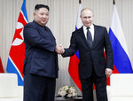 Russian President Vladimir Putin, right, and North Korea's leader Kim Jong Un shake hands during their meeting in Vladivostok, Russia, Thursday, April 25, 2019. Putin sat down for talks Thursday with North Korean leader Kim, saying the summit should help plan joint efforts to resolve a standoff over Pyongyang's nuclear program.(Sergei Ilnitsky/Pool Photo via AP)