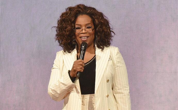 FILE - Oprah Winfrey makes opening remarks during