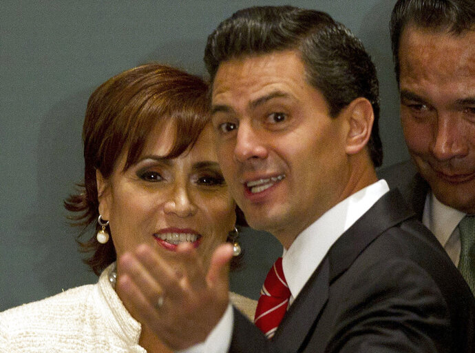 "FILE - In this Sept. 4, 2012 file photo, Mexico's President-elect Enrique Pena Nieto, of the Institutional Revolutionary Party (PRI), right, speaks with former Democratic Revolution Party (PRD) President Rosario Robles, during a ceremony at which Pena Nieto announced his transition team in Mexico City. A Mexican judge has ordered on Tuesday, Aug. 13, 2019, that Robles be held in preventive detention on corruption charges after prosecutors accused Robles of ""wrongful exercise of public service"" related to the alleged diversion of up to $260 million in public funds. Robles held multiple posts in Peña Nieto's administration, including as the secretary of Social Development. (AP Photo/Eduardo Verdugo, File)"