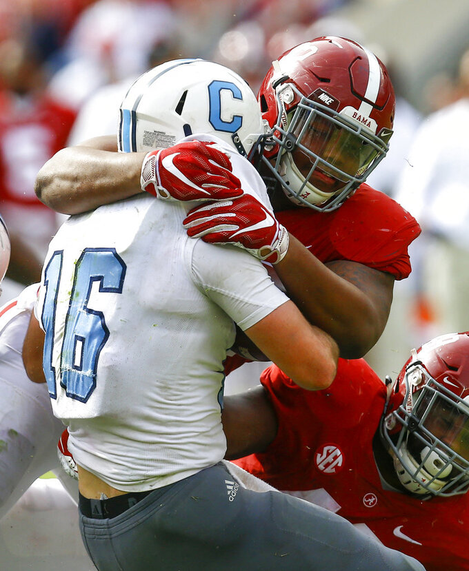 FILE - In this Nov. 17, 2018, file photo, Alabama defensive lineman Quinnen Williams (92) stops Citadel quarterback Brandon Rainey (16) during the second half of a game, in Tuscaloosa, Ala. Williams was named to the 2018 AP All-America NCAA college football team, Monday, Dec. 10, 2018.(92)(AP Photo/Butch Dill, File)