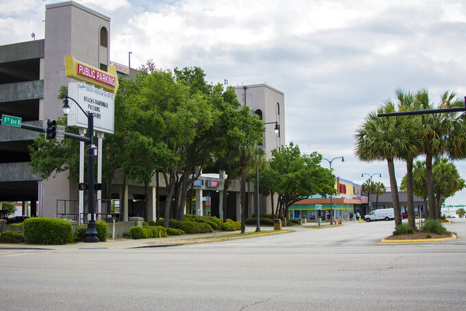 """The Pavilion Parking Garage is scheduled to be painted in early summer 2021 as part of a plan to beautify parts of downtown in Myrtle Beach, S.C., on Thursday, May 6, 2021. The Myrtle Beach Area Chamber of Commerce announced plans Thursday to paint downtown's lone public parking garage, sidewalks and crosswalks in bright colors for its new tourism advertising campaign, """"We are the beach."""" (Chase Karacosta/The Sun News via AP)"""