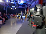 In this photo taken on Sept. 17, 2019, Students starting a university degree course in esports at Staffordshire University attend a welcome session at the school's new London outpost. A number of U.K. and U.S. universities are launching degrees in esports, or competitive multiplayer videogaming, to capitalize on the booming industry's growing demand for skilled professionals. (AP Photo/Kelvin Chang)