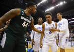 Duke guard Tre Jones (3) is consoled by Michigan State forward Nick Ward (44) after losing to Michigan State at the end of an NCAA men's East Regional final college basketball game in Washington, Sunday, March 31, 2019. (AP Photo/Alex Brandon)