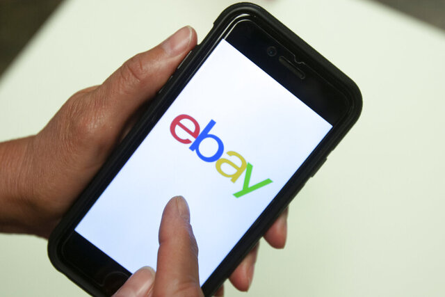 FILE - In this July 11, 2019, file photo, an Ebay app is shown on a mobile phone in Miami. The owner of the New York Stock Exchange has made an offer to buy online marketplace eBay Inc. That's according to a report by the Wall Street Journal on Tuesday, Feb. 4, 2020. (AP Photo/Wilfredo Lee, File)