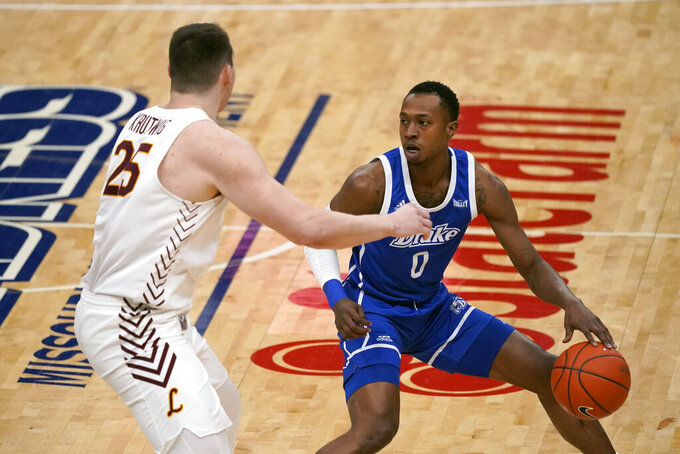 Drake's D.J. Wilkins (0) dribbles as Loyola of Chicago's Cameron Krutwig (25) defends during the first half of the championship game in the NCAA Missouri Valley Conference men's basketball tournament Sunday, March 7, 2021, in St. Louis. (AP Photo/Jeff Roberson)