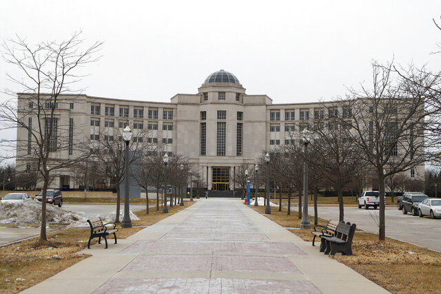 FILE - In this  Friday, Jan. 17, 2020, file photo, The Michigan Supreme Court's Hall of Justice is seen in Lansing, Mich. SANTA FE, N.M. _ Court majorities are at stake beyond Washington, D.C., as voters chose justices for state supreme courts that have been thrust into politicized clashes over voter access and the emergency powers of governors fighting the coronavirus outbreak. Michigan Gov. Gretchen Whitmer, a Democrat, wants to flip control of the state's Republican-majority high court. (AP Photo/Carlos Osorio, File)