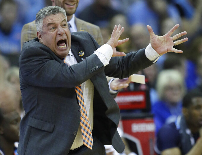 Auburn head coach Bruce Pearl yells from the sidelines during the first half of a men's NCAA tournament college basketball Midwest Regional semifinal game against North Carolina Friday, March 29, 2019, in Kansas City, Mo. (AP Photo/Orlin Wagner)