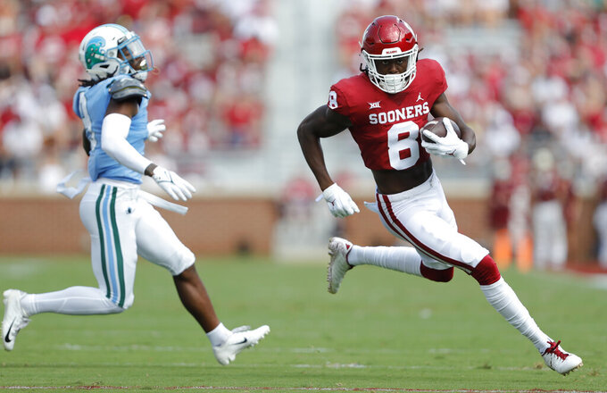 Oklahoma wide receiver Michael Woods II (8) runs ahead of Tulane cornerback Jaylon Monroe (9) during a NCAA college football game Saturday, Sept. 4, 2021, in Norman, Okla. (AP Photo/Alonzo Adams)