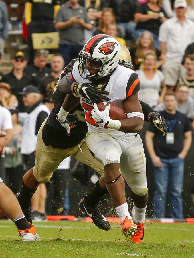 Oregon State running back Jermar Jefferson (22) runs against Colorado during the second half of an NCAA football game, Saturday, Oct. 27, 2018, in Boulder, Colo. Oregon State won, 41-34. (AP Photo/Jack Dempsey)