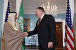 Secretary of State Mike Pompeo, right, shakes hands with Saudi Foreign Minister Faisal bin Farhan Al Saud, during a media opportunity, Wednesday, Feb. 12, 2020, at the State Department in Washington. (AP Photo/Luis M. Alvarez)