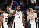 San Antonio Spurs center LaMarcus Aldridge (12) celebrates with teammates after he was fouled while scoring late in the the second half of an NBA basketball game against the Brooklyn Nets in San Antonio, Thursday, Jan. 31, 2019. San Antonio won 117-114. (AP Photo/Eric Gay)