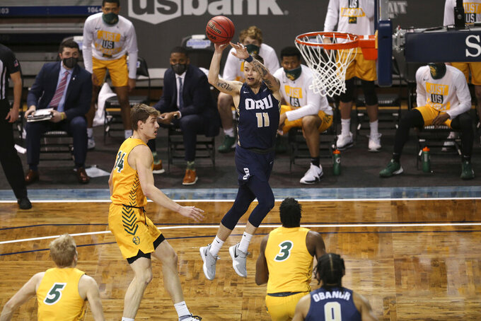 Oral Roberts guard Carlos Jurgens (11) passes to a teammate during the first half against North Dakota State in an NCAA college basketball game for the Summit League men's tournament championship Tuesday, March 9, 2021, in Sioux Falls, S.D. (AP Photo/Josh Jurgens)