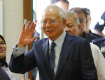 FILE - In this Oct. 4, 2018, file photo, former Malaysian Prime Minister Najib Razak walks into courtroom at Kuala Lumpur High Court in Kuala Lumpur, Malaysia. Najib is hardly lying low ahead of his corruption trial set to begin Tuesday, Feb. 12, 2019, on charges related to the multibillion-dollar looting of the 1MDB state investment fund. He's crooned about slander in an R&B video and vilified the current government on social media to counter portrayals of him as corrupt and out of touch. Najib denies wrongdoing and his lawyers are seeking delay. (AP Photo/Vincent Thian, File)