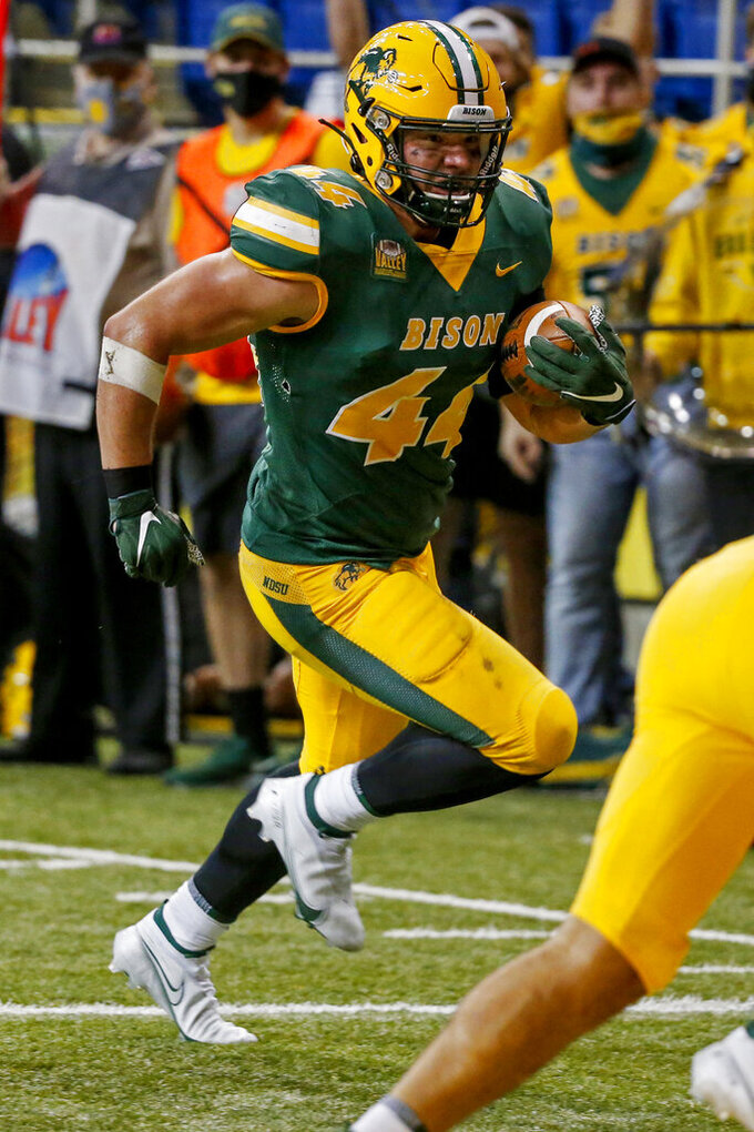 North Dakota State fullback Hunter Luepke runs against Central Arkansas for a touchdown in the fourth quarter of an NCAA college football game Saturday, Oct. 3, 2020, in Fargo, N.D. North Dakota State won 39-28. (AP Photo/Bruce Kluckhohn)