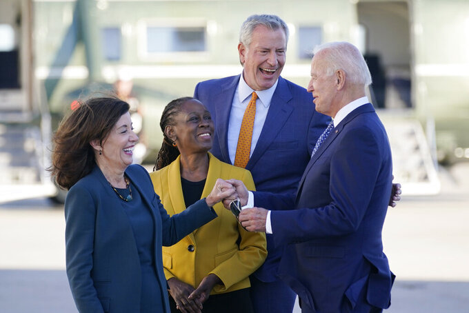 President Joe Biden speaks with New York Gov. Kathy Hochul, left, New York Mayor Bill de Blasio and his wife Chirlane McCray, center left, as he arrives at John F. Kennedy Airport for a two day visit to attend the United Nations General Assembly, Monday, Sept. 20, 2021, in New York. (AP Photo/Evan Vucci)
