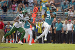 Jacksonville Jaguars cornerback A.J. Bouye (21) intercepts a pass in front of New York Jets wide receiver Vyncint Smith during the second half of an NFL football game, Sunday, Oct. 27, 2019, in Jacksonville, Fla. (AP Photo/Phelan M. Ebenhack)