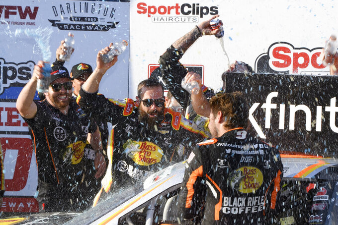 Noah Gragson is showered by crew members in victory lane after winning a NASCAR Xfinity Series auto race Saturday, Sept. 4, 2021, in Darlington, S.C. (AP Photo/John Amis)