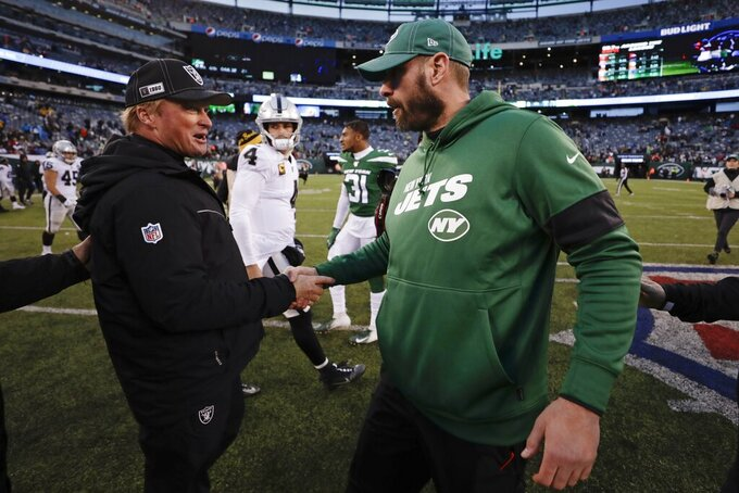 Oakland Raiders head coach Jon Gruden, left, shakes hands with New York Jets head coach Adam Gase after an NFL football game Sunday, Nov. 24, 2019, in East Rutherford, N.J. The Jets won 34-3. (AP Photo/Adam Hunger)