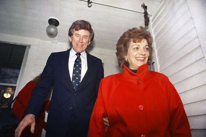 FILE - In this Dec. 15, 1987 file photo, Former Colorado Sen. Gary Hart and his wife Lee are all smiles as they leave the home, Dec. 15, 1987 of a Concord supporter enroute to the New Hampshire Secretary of State's office in Concord, N.H.. Lee Hart, the wife of former U.S. Sen. Gary Hart of Colorado, has died Friday, April 9, 2021 . She was 85.(AP Photo/Chris Cardner)
