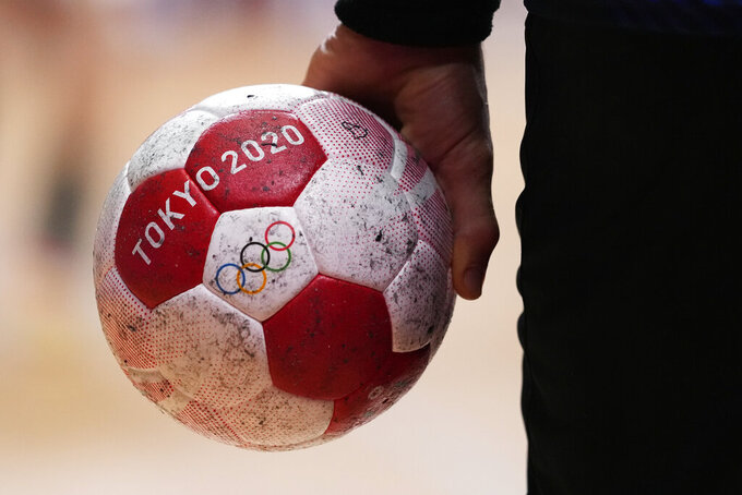 Argentina's Lucas Dario Moscatello holds the ball during the men's preliminary round group A handball match between Argentina and Germany at the 2020 Summer Olympics, Monday, July 26, 2021, in Tokyo, Japan. (AP Photo/Pavel Golovkin)