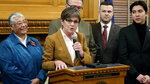 FILE- In this Jan. 15, 2019 file photo, Kansas Gov. Laura Kelly discusses a new executive order that reinstates a past ban on anti-LGBT bias in state employment decisions and extends the policy to government contractors, at the Statehouse in Topeka, Kan. Standing to the Democratic governor's left is state Rep. Susan Ruiz, D-Shawnee, one of two openly LGBT lawmakers elected last year. (AP Photo/John Hanna, File)