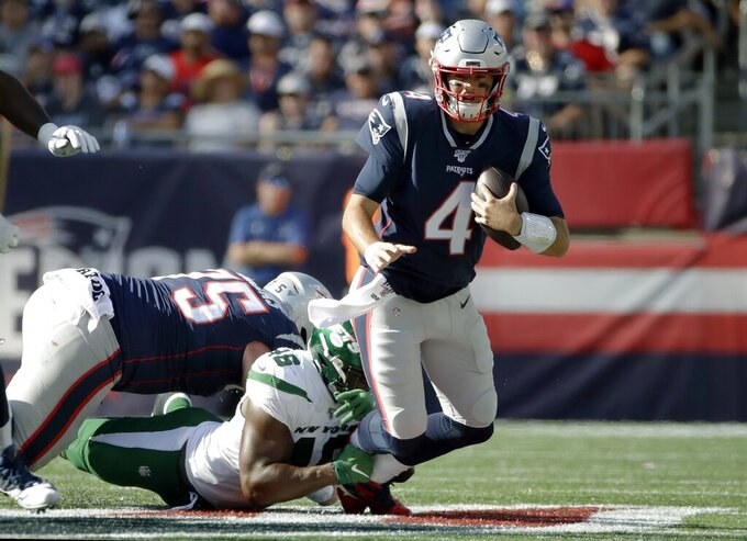 New York Jets linebacker Neville Hewitt (46) sacks New England Patriots quarterback Jarrett Stidham (4) in the second half of an NFL football game, Sunday, Sept. 22, 2019, in Foxborough, Mass. (AP Photo/Elise Amendola)