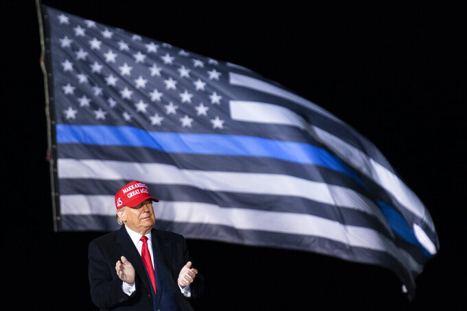 President Donald Trump arrives to speak during a campaign rally at Southern Wisconsin Regional Airport, Saturday, Oct. 17, 2020, in Janesville, Wis. (AP Photo/Alex Brandon)