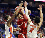 Arkansas forward Daniel Gafford (10) is trapped between Florida defenders Kevarrius Hayes, left, and Andrew Nembhard (2) in the first half of an NCAA college basketball game at the Southeastern Conference tournament Thursday, March 14, 2019, in Nashville, Tenn. (AP Photo/Mark Humphrey)
