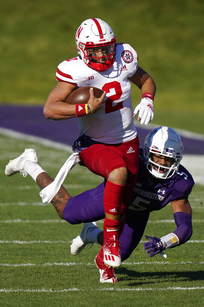 Nebraska quarterback Adrian Martinez, left, is tackled by Northwestern defensive back JR Pace during the second half of an NCAA college football game in Evanston, Ill., Saturday, Nov. 7, 2020. Northwestern won 21-13. (AP Photo/Nam Y. Huh)