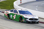 Kevin Harvick (4) drives during a NASCAR Cup Series auto race Wednesday, June 10, 2020, in Martinsville, Va. (AP Photo/Steve Helber)