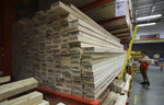 FILE - In this July 11, 2019, file photo lumber is stacked at the Home Depot store in Londonderry, N.H. The Home Depot Inc. on Tuesday, Aug. 20, reported fiscal second-quarter net income of $3.48 billion. Home Depot cut its sales expectations for the year as lumber prices slid and the company braces for the potential impact of tariffs on its customers. (AP Photo/Charles Krupa, File)