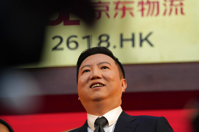 JD Logistics CEO Rui Yu attends a ceremony to virtually observe the listing of the company on the Hong Kong stock exchange from JD.com headquarters in Beijing on Friday, May 28, 2021. JD Logistics' shares jumped 14% in their trading debut Friday in Hong Kong. The company is a subsidiary of Chinese e-commerce giant JD.com. It is the latest technology company to list in the semi-autonomous Chinese city as Beijing intensifies scrutiny of the technology sector. (AP Photo/Ng Han Guan)