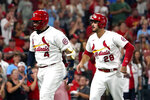 St. Louis Cardinals' Yadier Molina (4) celebrates after hitting a two-run home run as teammate Nolan Arenado (28) watches during the fourth inning of a baseball game against the Cincinnati Reds Friday, Sept. 10, 2021, in St. Louis. (AP Photo/Jeff Roberson)