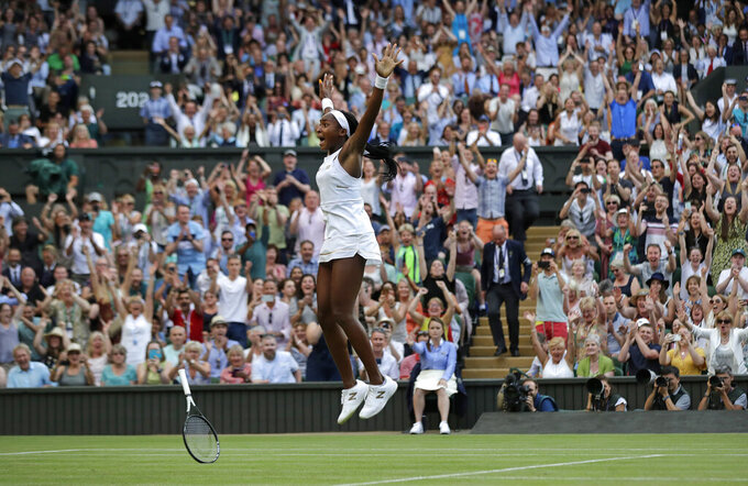 "File-This July 5, 2019 file photo shows United States' Cori ""Coco"" Gauff celebrating after beating Slovenia's Polona Hercog in a Women's singles match during day five of the Wimbledon Tennis Championships in London. Wimbledon's next and from afar, Comes Coco Gauff, uncharted star. (AP Photo/Ben Curtis, File)"